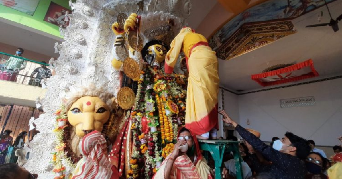 according-to-the-custom-the-men-of-bhadreshwar-welcome-the-goddess-jagadhatri-pujo-with-the-veil-on-their-heads